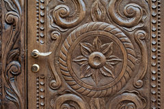 Beautiful ornately carved wooden panel in an antique door Stock Photography