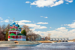 Beautiful orthodox church is located on the riverbank Royalty Free Stock Photo