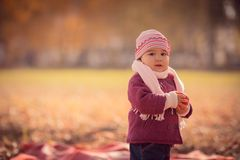 Beautiful outdoor autumn portrait of adorable toddler girl Stock Photo