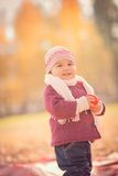 Beautiful outdoor autumn portrait of adorable toddler girl Royalty Free Stock Photo
