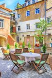 Beautiful outdoor cafe in the patio at Old Town of Vilnius, Lithuania stock photos