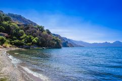 Beautiful outdoor view of shore at Lake Atitlan, during a gorgeous sunny day and blue water in Guatemala stock images