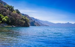 Beautiful outdoor view of shore at Lake Atitlan, during a gorgeous sunny day and blue water in Guatemala stock photo