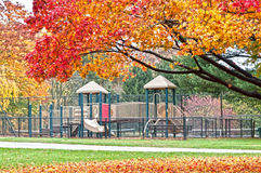 Beautiful outdoors - playground in autumn park Stock Images