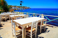 Beautiful outdor cafe on sea coast, Crete island, Greece. Royalty Free Stock Image