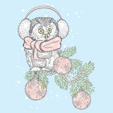 Beautiful owl wearing a scarf. Bird on a branch Christmas decorations. New Year`s and Christmas. Beautiful owl wearing a scarf. Bird on a branch Christmas Stock Images