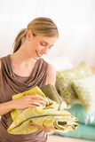 Beautiful Owner Examining Sheet In Bedding Store Stock Photo