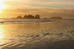 Dramatic Stormy Sunset at South Chesterman Beach near Tofino, Vancouver Island. Beautiful Pacific sunset reflected on the wet sand at Chesterman Beach near stock photos