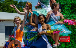 Beautiful Pageant roaylty on a float Royalty Free Stock Image