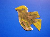 Beautiful painted bird on blue background Royalty Free Stock Photo