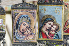 Beautiful painted hanging greek icons. Beautiful painted  greek icons in souvenir shop Stock Image