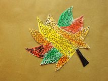 Beautiful painted leaf  on brown background Stock Image
