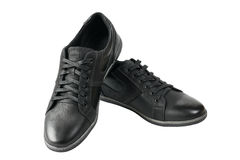 Beautiful pair of black mens sport shoes isolated on white background. Men`s shoes for sports Royalty Free Stock Photo