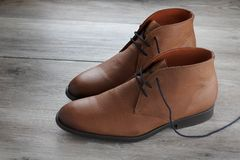 Pair of brown leather men`s dress boots stock images