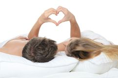 Beautiful pair lays in a bed Stock Images