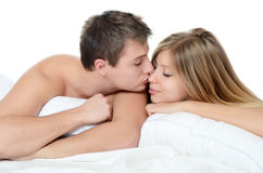 Beautiful pair lays in a bed Royalty Free Stock Image