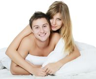 Beautiful pair lays in a bed Stock Photography