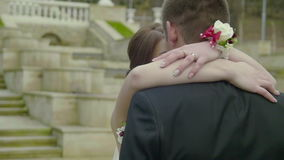 Beautiful pair of lovers newlyweds embracing in the park.  stock video footage