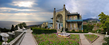 Beautiful palace. Beautiful historic palace in the background of the cloudy sky Royalty Free Stock Photography