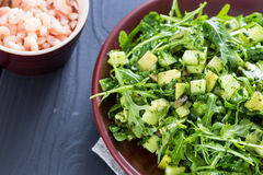 Beautiful Paleo Green Salad with Cucumber and Avocado on a Dark Grey Wooden Background with Plate of Shrimps, Horizontal, Close-up Royalty Free Stock Photo