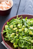 Beautiful Paleo Green Salad with Cucumber and Avocado on a Dark Grey Wooden Background with Plate of Shrimps, Vertical, Close-up Stock Photo