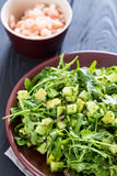 Beautiful Paleo Green Salad with Cucumber and Avocado on a Dark Grey Wooden Background with Plate of Shrimps, Vertical, Close-up. Beautiful Paleo Green Salad Stock Photography