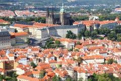Panorama of Prague, tilt shift effect. Beautiful panorama of the city and old houses over Prague, tilt shift effect stock photos