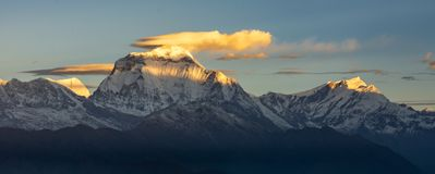 Beautiful Panorama of Dhaulagiri summit and clouds during sunrise from Poonhill, Himalayas royalty free stock photography
