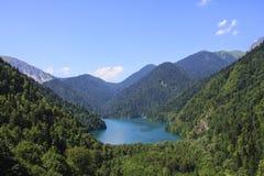 Beautiful panorama Lake Riza. Beautiful panorama of natural mountain landscape. Blue Lake Ritsa among mountains of the Caucasus, Abkhazia. Ritz Park Stock Images