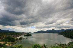 Large Lake among Hills under Grey Clouds in Vietnam Stock Photography