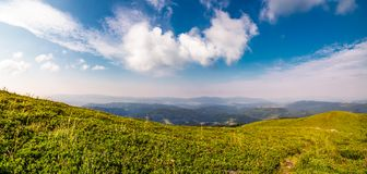 Beautiful panorama of mountainous landscape. Blue sky with some clouds over the grassy slope of a mountain ridge. lovely summer weather Royalty Free Stock Images