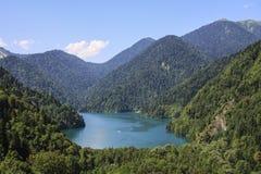Beautiful panorama Lake Riza. Beautiful panorama of natural landscape. Blue Lake Ritsa among mountains of the Caucasus, Abkhazia. Ritz Park Royalty Free Stock Images