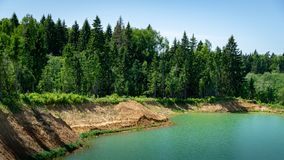 Free Beautiful Panorama Of Quarry Lake With Emerald Green Water And Big Forest As Background. Closed Down Quarry Now Stock Photos - 157045513