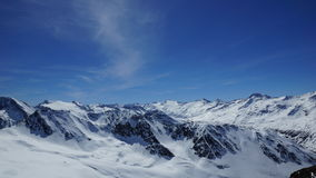 Beautiful panorama over the summits of the mountains in winter. Nice panorama over the summits of the mountains in winter and a lot of snow Stock Image