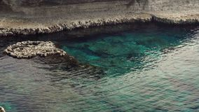 Beautiful panorama of rocks and turquoise mediterranean sea at landmark Cape Greco Cyprus. Seashore at summer. Calm crystal water stock footage