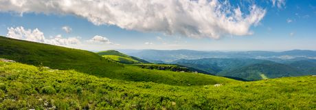 Beautiful panorama of Runa mountain hills. Wonderful cloudscape on a blue sky over the distant mountain range. breathtaking view of mountainous summer Royalty Free Stock Images