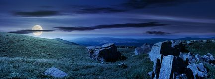 Beautiful panorama of Runa mountain at night. In full moon light. huge rocky formation on the hillside and peak in the distance. wonderful landscape of stock photography