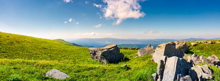 Beautiful panorama of Runa mountain in summer. Huge rocky formation on the hillside and peak in the distance. wonderful landscape of Carpathians stock images