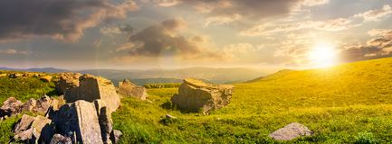 Beautiful panorama of Runa mountain at sunset. Huge rocky formation on the hillside and peak in the distance. wonderful landscape of Carpathians Royalty Free Stock Photography