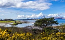 View of Castle Stalker and Port Appin Harbour in the Highlands of Scotland. This beautiful panorama shows the coast of Loch Linnhe, with Castle Stalker on a Royalty Free Stock Photography