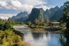 Beautiful panorama of the surroundings of Vang Vieng, Laos and Nam Song river. Beautiful panorama of the surroundings of Vang Vieng, Laos, Asia, and Nam Song royalty free stock photo
