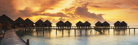 Beautiful panorama of tropical sunset. With water villas stock images