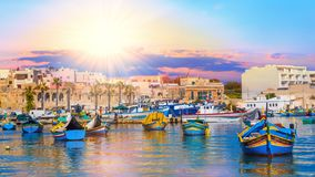 Valletta horbor of Malta. Beautiful panorama of Valletta harbor in Malta, with boats and architecture illuminated by sunset light stock image
