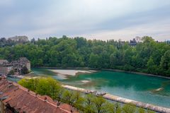 Beautiful panorama view of aare river on cloud blue sky background. Beautiful panorama view of aare river with lush trees on cloud blue sky background royalty free stock photos