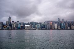 Beautiful panorama view of business district of hong kong city and river on overcast sky background stock images