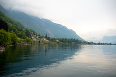 Beautiful panorama view of Geneva lake and small village on mountain and cloudy sky background. With copy space, Montreux, Switzerland royalty free stock images
