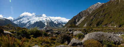 Beautiful panorama view of snow mountain during walk to Mount Cook, South Island, New Zealand Stock Photos