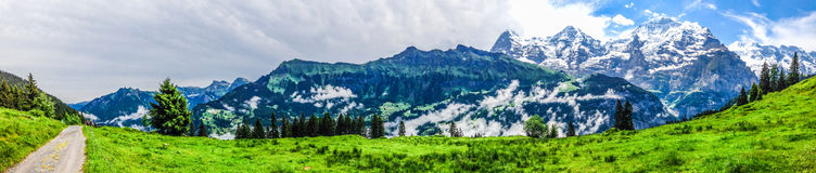 Beautiful Panorama view of Swiss Alps mountains from Murren. Gimmelwald trail, Jungfrau Region, Bernese Oberland, Berne Canton, Switzerland, Europe. Great Royalty Free Stock Photos