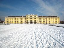Beautiful panorama view in winter an atmosphere with the austrian palace in vienna covered with snow stock photography