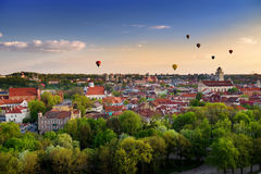 Beautiful panorama of Vilnius old town with hot air balloons in the sky Stock Photo